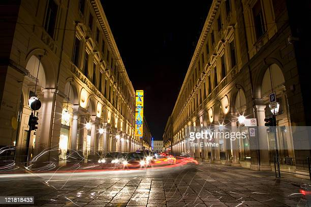 City streets at night with traffic trails, Turin, Italy