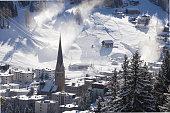 DAVOS, SWITZERLAND city sunrise aerial panorama in  sunny winter day horizontal. church close up