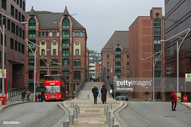 A city tour bus travels through the Sandtorpark district in the HafenCity development in Hamburg Germany on Friday Feb 13 2015 UnibailRodamco SE will...