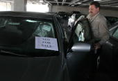City Toyota service manager Jim Lasseter unlocks a brand new Toyota Camry that has a 'not for sale' sign in the window February 3 2010 in Daly City...