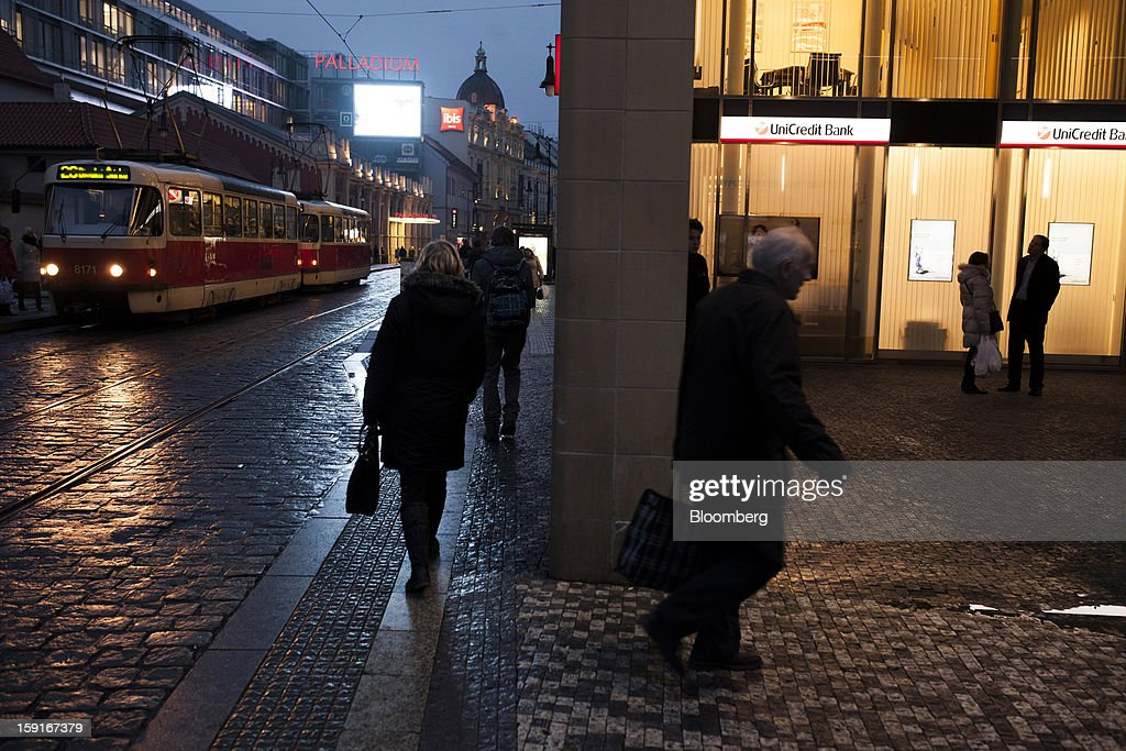 A city tram passes a Unicredit Bank Czech Republic SA office in Prague, Czech Republic, on Tuesday, Jan. 8, 2013. The Czech economy is showing weak domestic demand as households and businesses cut spending due to government austerity programs and the euro area's debt crisis. Photographer: Bartek Sadowski/Bloomberg via Getty Images