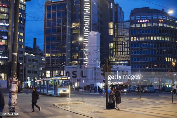 City trams operate at night in the city center in Oslo Norway on Wednesday Sept 20 2017 Norways sovereign wealth fund hit $1 trillion for the first...