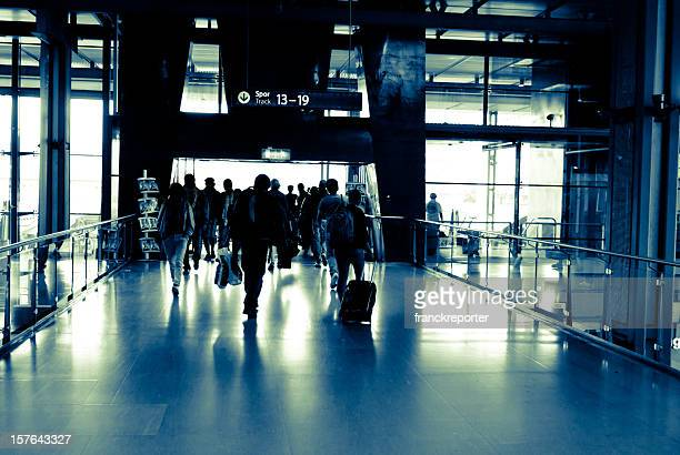 city travellers at rushing through modern exit airport