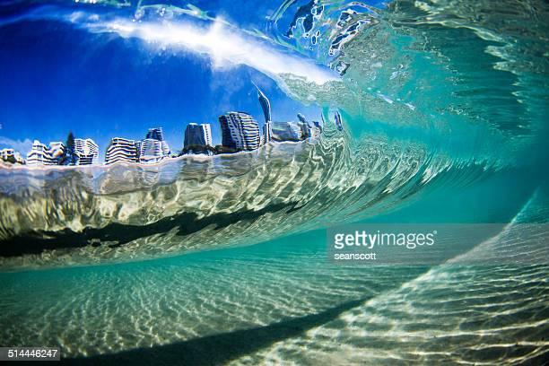 City view through wave, Gold Coast, Queensland, Australia