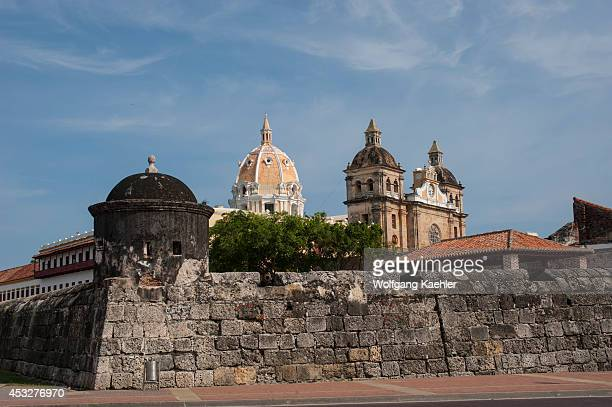 City wall of the old walled city of Cartagena Colombia with San Pedro Claver church in background
