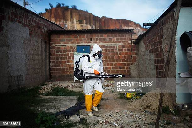 A city worker fumigates in an effort to eradicate the mosquito which transmits the Zika virus on February 4 2016 in Recife Pernambuco state Brazil...