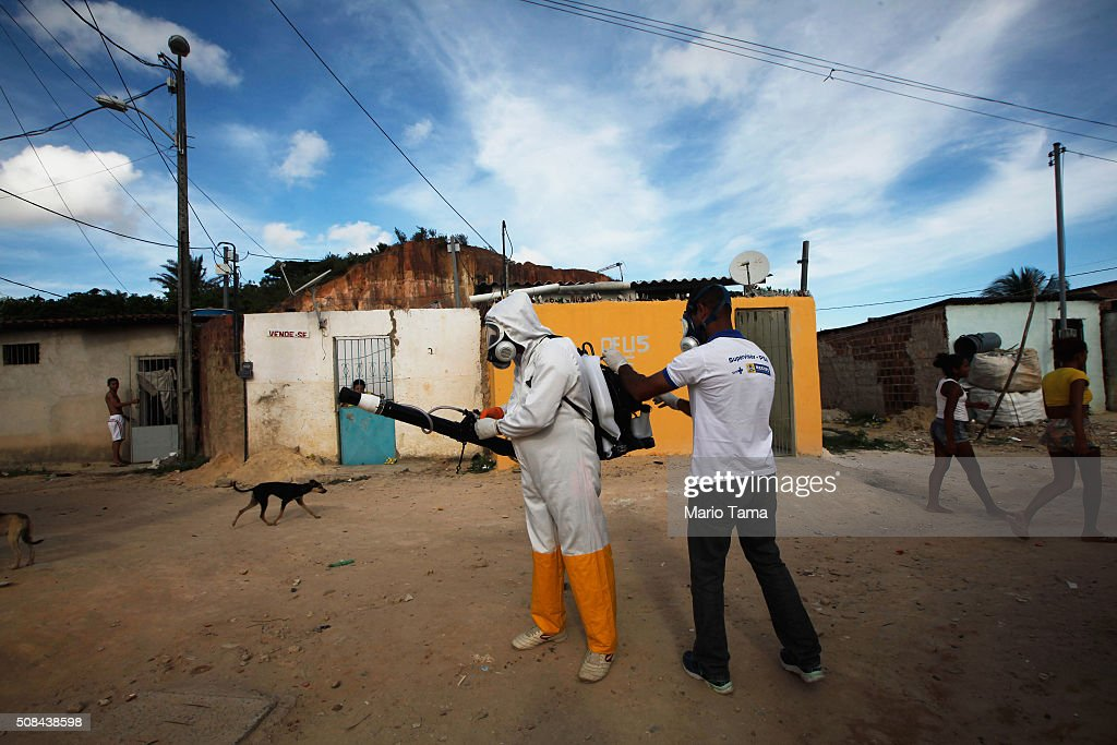 A city worker prepares to fumigate in an effort to eradicate the mosquito which transmits the Zika virus on February 4, 2016 in Recife, Pernambuco state, Brazil. Officials say as many as 100,000 people may have already been exposed to the Zika virus in Recife, which is being called the epicenter of the crisis, although most never develop symptoms. Tourists are arriving in the city for its famed Carnival celebrations which begin tomorrow.