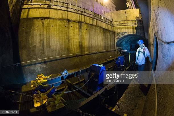 A city worker stands next to a large sewercleaning boat after it was lowered into the city's sewers through a large hatch at the corner of rue Monge...