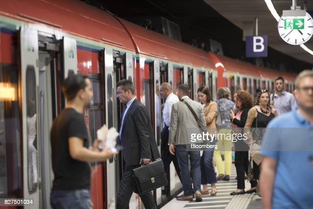 City workers board a train during the evening commute at Taunusanlage SBahn underground railway station in Frankfurt Germany on Monday Aug 7 2017...