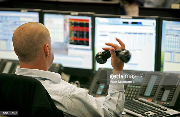 City workers buy and sell stocks on the BGC trading floor on September 7 2005 in London