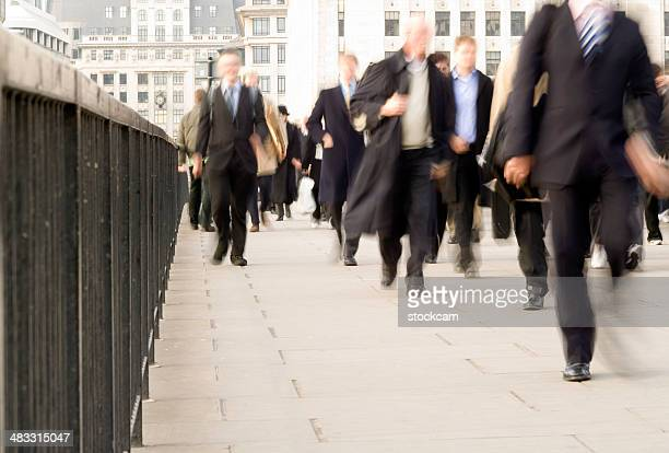 City workers commuters walking with movement blur