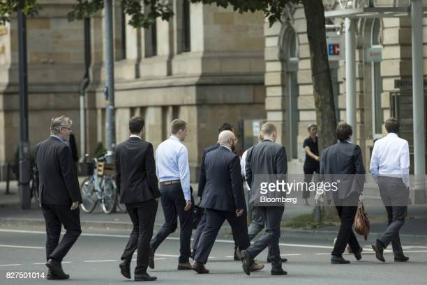 City workers cross a road during a lunch break in the financial district of Frankfurt Germany on Monday Aug 7 2017 London could lose 10000 banking...