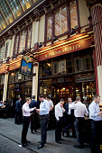 City workers having a drink outside the New Moon pub in Leadenhall Market in the City of London Located in Gracechurch Street the market dates back...