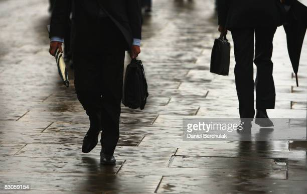 City workers make their way through the City Of London's financial district on September 30 2008 in central London England Financial turmoil...
