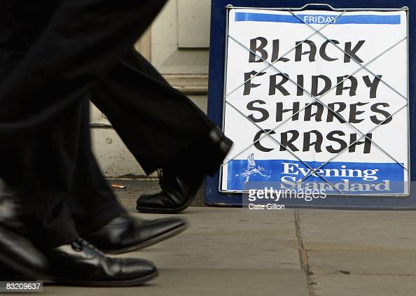 City workers pass the Evening Standard headline board showing the words 'Black Friday Shares Crash' during lunch time on Friday on October 10 2008 in...