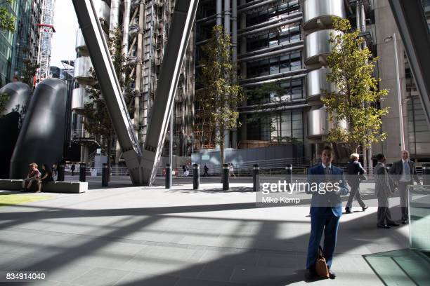 City workers passing by outside the Lloyds Building in the City of London England United Kingdom The Lloyd's building is the home of the insurance...