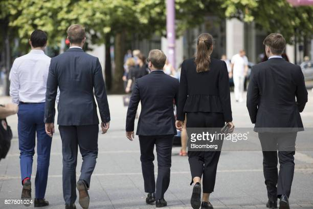 City workers stroll during a lunch break in the financial district of Frankfurt Germany on Monday Aug 7 2017 London could lose 10000 banking jobs and...