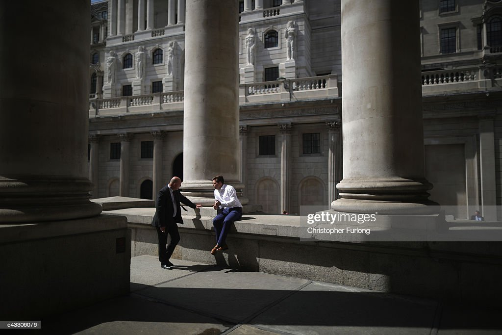 City workers talk during a break near the Bank of England as the financial markets face uncertainty in the wake of Brexit on June 27, 2016 in London, England. Earlier today Chancellor George Osborne said that contingency plans were in place to shore up the economy amid ongoing market volatility after Britain's vote to exit the European Union.