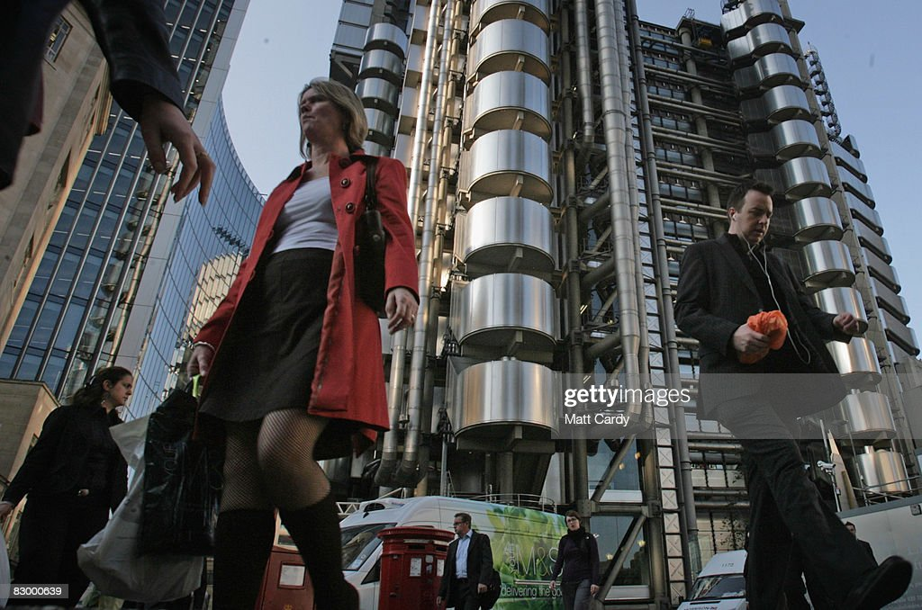 City workers walk opposite the Lloyd's Building, the home of the insurance institution Lloyd's of London on September 25 2008 in London, England. Lloyds of London are due to announce their interim results today as US President George Bush calls for the Ameriacn people to support his multi billion dollar rescue plan for the US economy.