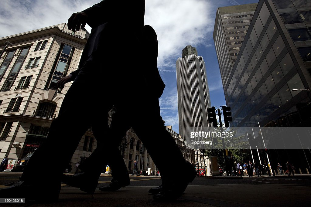 City workers walk past Tower 42, center, in London, U.K., on Friday, Aug. 17, 2012. Banks, insurers and other financial-services firms may eliminate a total of about 3,000 jobs across greater London as companies in the New York region add 9,000, according to U.K.-based researcher Oxford Economics Ltd. Photographer: Simon Dawson/Bloomberg via Getty Images