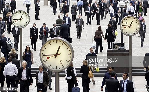 City workers walk through London's Canary Wharf on September 16 2008 World equities plunged for a second day running on Tuesday as investors in...