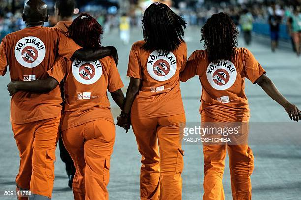 TOPSHOT City's cleaning workers are seen with the legend 'Out Zika' in portuguese on their uniforms between the samba schools' during the second...