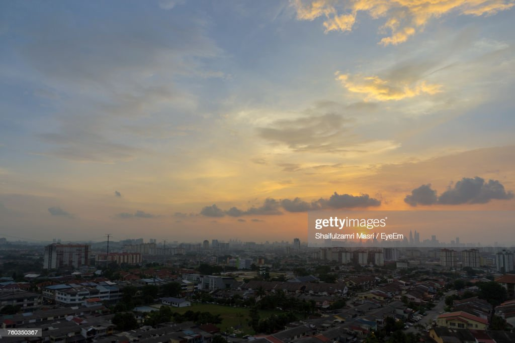 Cityscape Against Cloudy Sky During Sunset : Stock Photo