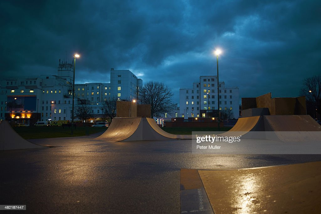 Cityscape and skateboard park at night