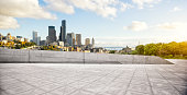 cityscape and skyline of los angeles from empty brick floor