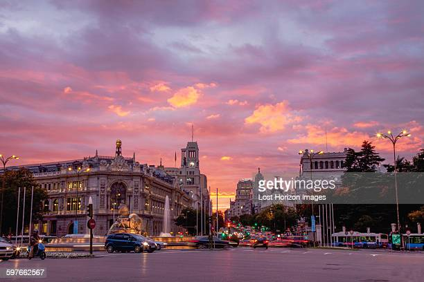 Cityscape and traffic with pink sunset, Madrid, Spain