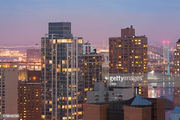 Cityscape and Triborough bridge at dusk, New York City, USA