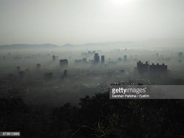Cityscape In Morning Mist Against Clear Sky
