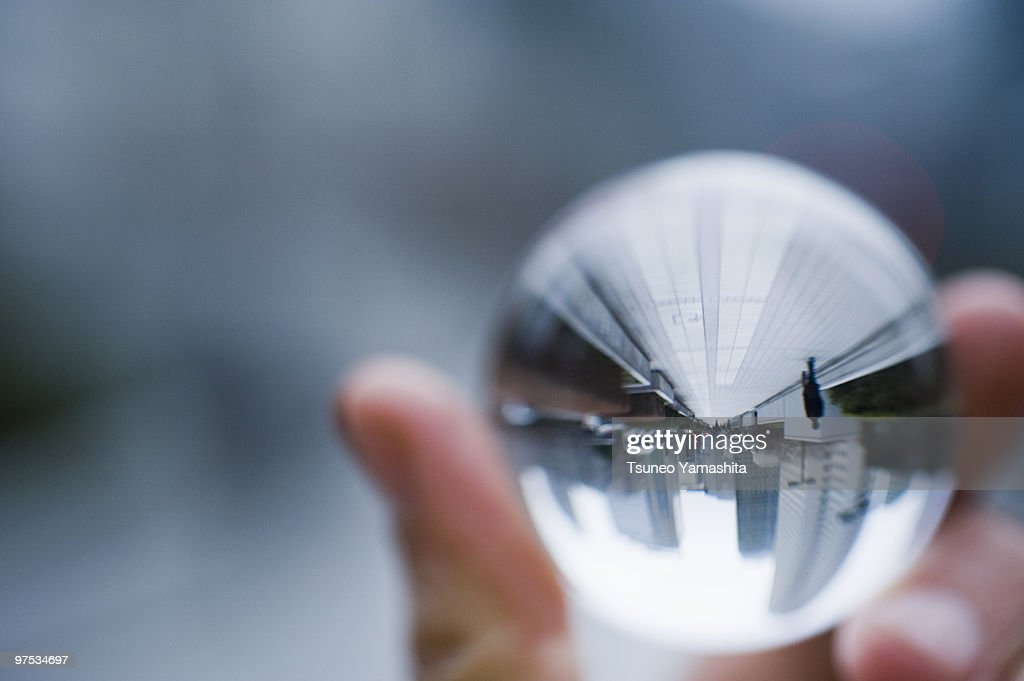 Cityscape in the glass ball : Stock Photo