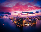 Aerial view of Hong Kong City in magic hour, shooting from drone angle.
