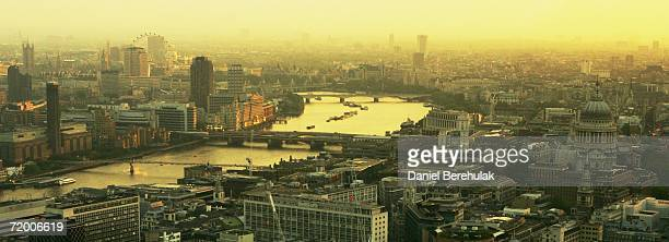 A cityscape of London including landmarks of the Thames river the London Eye St Paul's Cathedral and Big Ben are pictured from St Mary's Axe...