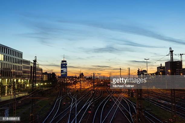 Cityscape of Munich with rail tracks after sunset