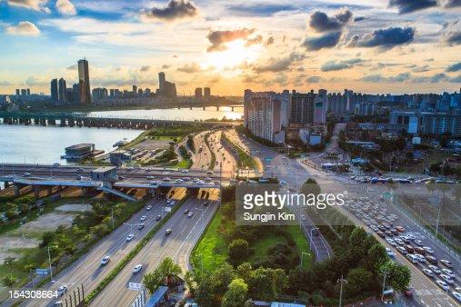 Cityscape of riverside by sunset : Stock Photo