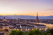 Cityscape of Torino (Turin, Italy) at sunsetwith colorful clear sky. The Mole Antonelliana towering on the city.