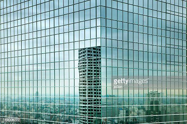 Cityscape reflected in glass windows, Shinjuku