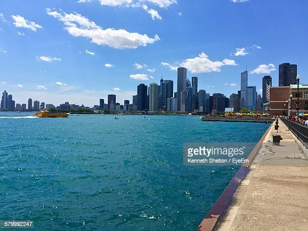 Cityscape Seen From Navy Pier On Lake Michigan Against Sky
