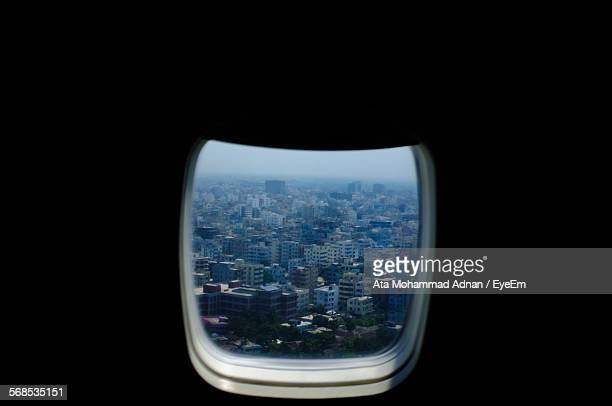 Cityscape Seen Through Airplane Window