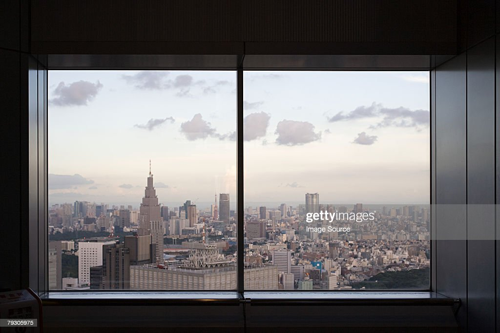 Cityscape through window : Stock Photo
