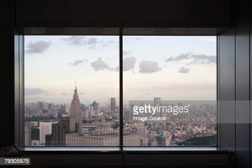 Cityscape through window : Stock Photo