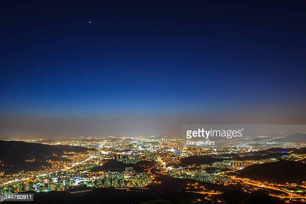 Cityscape viewed from mountain at night
