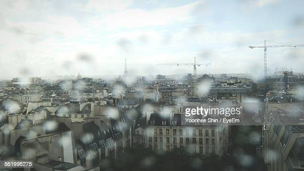 Cityscape Viewed From Wet Window Glass
