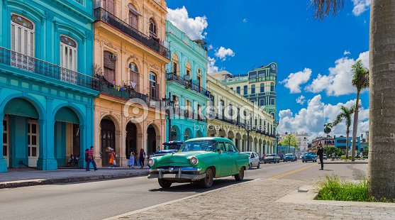 Cityscape with american green vintage car on the main street in Havana City Cuba - Serie Cuba Reportage : Stock Photo