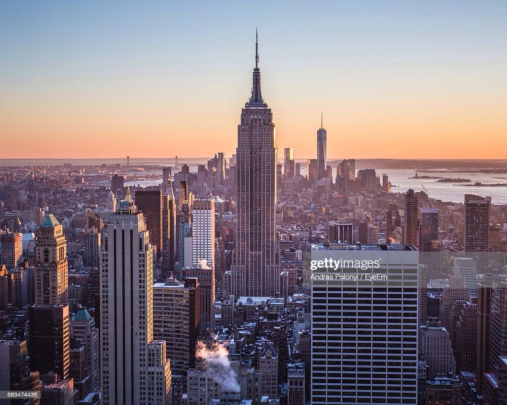 Cityscape With Empire State Building Against Clear Sky During Sunset