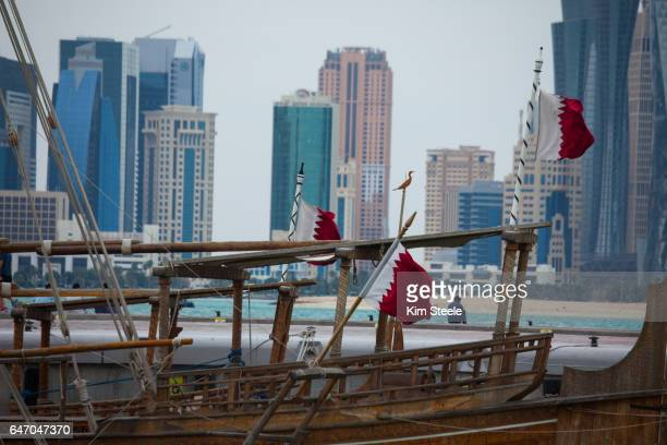 DOHA QATAR cityscapes with modern architecture and Persian Gulf and dhow foreground