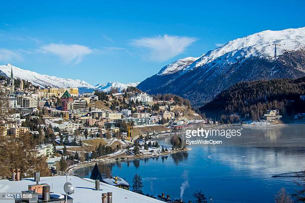 Cityview and panoramic landscape with the frozen Lake St Moritz and the luxury Palace Hotel on December 14 2013 in St Moritz Engadin Graubunden...