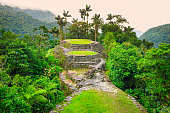 Photo of ancient terraced structures, stonework, architecture at Ciudad Perdida (Lost City) in the Colombian Highlands, Colombia's Sierra Nevada Mountains, South America.